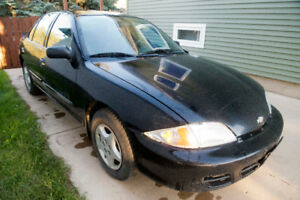 2002 Chevrolet Cavalier runs and drives. As is or for parts