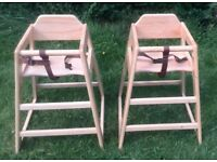 Two light wood high chairs. with safety belts ideal for Twins.