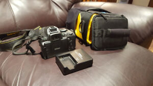 Nikon D5100  with extra 35mm fixed lens