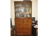 Chest of drawers with 5 drawers. Glass fronted display cabinet above.
