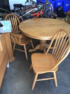 Solid oak table and chairs dining room