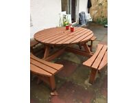 Round garden table bench set sits 8
