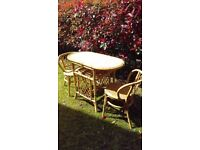 Conservatory Bamboo Table and two chairs.... Oval in shape.