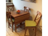 Drop leaf table, four chairs and seat pads