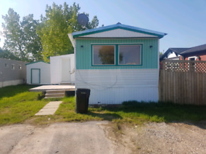 Mobile home beaverlodge for rent pet friendly with huge shed!