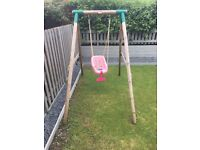 Little Tikes Wooden swing. 2 years old. Comes with baby seat with harness & additional seat