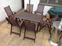 Wooden patio reclining six chairs and a table with cushions