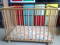 Baby play pen on casters
