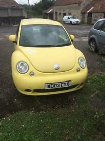 Yellow VW beetle 1.9 TDI