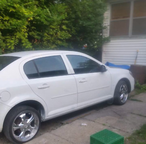 2007 800 $ chev cobalt and  FALKEN CHROME rims   800 cash
