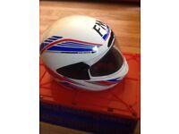 2 helmets for sale! Bargain! £10 for both. One black, one white