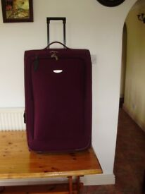 "Pair of Redland wheeled maroon suitcases height 73cm (28.5""), Width45cm (18"") depth 27.5cm (11"")"