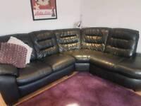 Large black leather corner sofa.