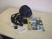 Nikon D3100 With 18-55mm, Bag, Charger, magazine, guide.