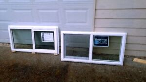Two NEW windows w screens for sale