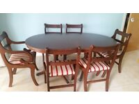 Mahoganny dining room table and chairs. Good DIY project