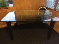 Glass and leather dining table