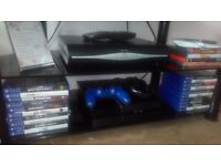 Black ps4 with 20games and 2 pads and a charger wire for pads