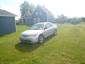 2003 Honda Civic 2 door. Inculsede rimes and tires for winter