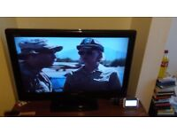 Wide screen black 32in TV for sale