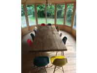 Large dining table with steel hairpin legs.
