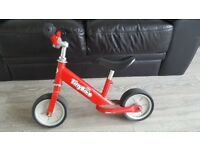 Red TinyBike balance bike. Perfect first bike with thick tyres for great balance.