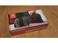 Nintendo switch (boxed) + mario kart + zelda