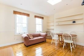 Two double bedroom top floor apartment with outside space on fashionable Redchurch Street.