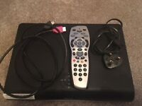 Two Sky + HD WiFi Boxes with remotes and cables