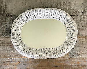 Oval wicker wall mirror