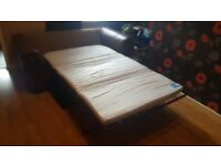Double sofa bed half leather in good condition. £100 pick up only