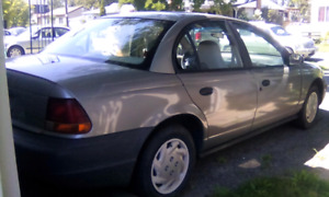 1997 Saturn  with new Snow Tires $ 800 or Best Offer!!!