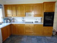 Oak kitchen with worktops, stainless steel sink and Neff appliances in very good condition.