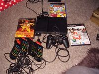 PLAYSTATION 2 SLIMLINE WITH GAMES AND BUZZERS