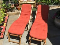 Wooden garden deck chairs and cushions
