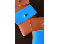 Three handmade faux leather pouches