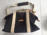 Storksak changing bag with mat and bottle holder