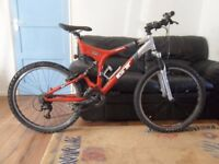 "GT I-Drive 3.0 full suspension 24 speed 20"" frame 26"" wheels color red"