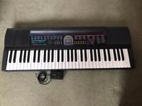 Casio CTK 485 keyboard with a collapsible stand