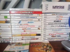 HUGE Nintendo Wii Collection !! Over 60 games, rockband !!