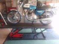 Motorcycle hydraulic lift/workbench.