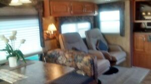 28.9 foot cougar fifth wheel with 2 seperate bedrooms sleeps 9