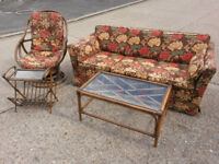 Sofabed, matching rattan rocking chair, matching rattan coffee table and newspaper tidy