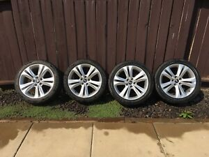 """Set of four 18"""" rims with tires."""