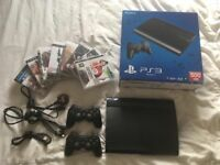 500GB black charcoal PS3 an 8 Games