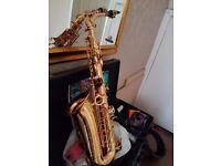 Alto Saxophone for sale. Gold, excellent condition.