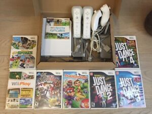Nintendo Wii with 2 Controllers and 8 Games
