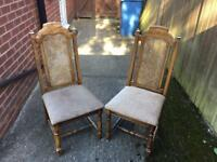 Two vintage chairs with high back and padded seats