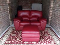 Red Italian Leather two seater sofa with matching footstool