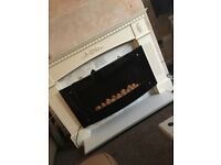 Electric fire and surround .. remote control